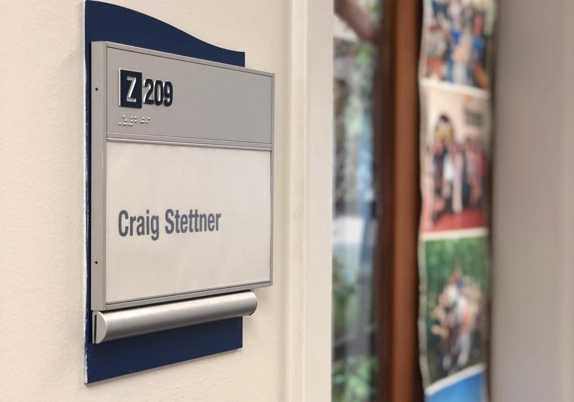 The nametag next to professor Stettner's office in the springtime after his passing.