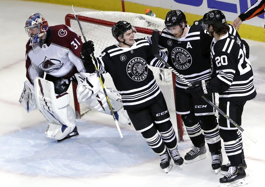Left to right: Alex DeBrincat, Duncan Keith, and Brandon Saad of the Chicago Blackhawks celebrate in their Winter Classic sweaters after scoring a goal against the Colorado Avalanche on Friday November 29th, 2019.