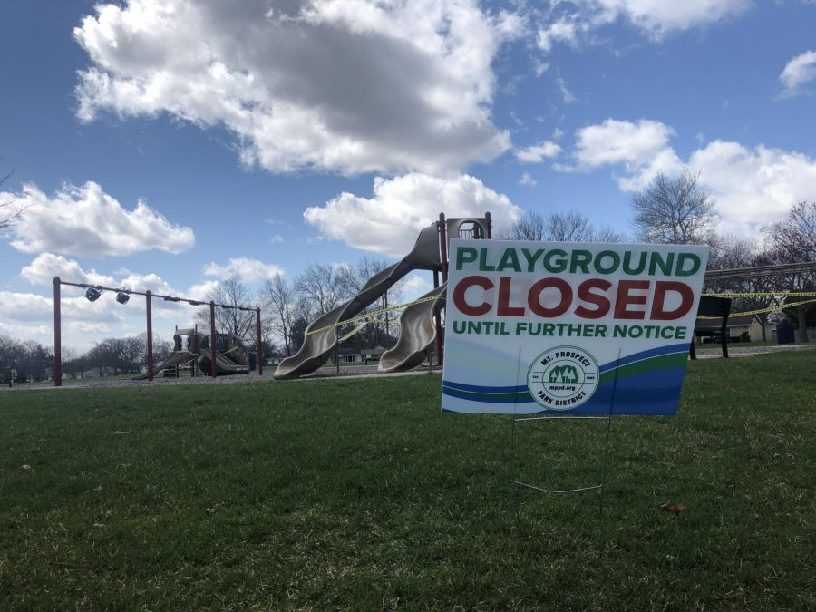 Per Illinois' rules, all public playgrounds are closed until further notice. The Mt. Prospect Park District has wrapped yellow tape around all playground amusements at Sunset Park to discourage play. Photo by Eddie Brown.