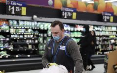 Due to the growing impact of COVID-19 in Illinois, Walmart and other stores encourage the use of masks and enforce mandatory social distancing to protect the health and safety of employees and customers. Photo by of Jeremy Haynes.