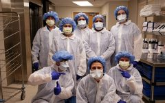 Teresa D'Alesio (center standing) and Central Sterilization Department staff with their new gowns on March 15th, 2020 before the coronavirus hit AMITA Health Alexian Brothers Medical Center in Elk Grove Village, IL. Photo Courtesy of Gianna D'Alesio.