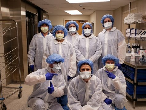 Teresa D'Alesio (center standing) and Central Sterilization Department staff with their new gowns on March 15th, 2020 before the coronavirus hit AMITA Health Alexian Brothers Medical Center in Elk Grove Village, IL. Photo Courtesy of Gianna D