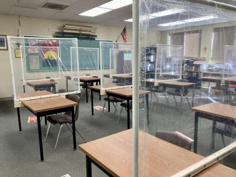 Dividers made of PVC pipe and shower curtains stand on socially distanced tables at Immanuel Lutheran School on October 9, 2020. Photo courtesy of Maggie Walsh.