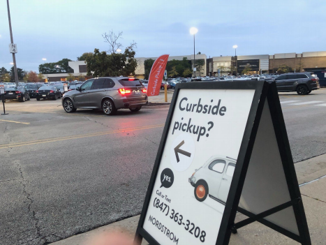 A sign outside of Nordstrom store indicating the next steps for customers who ordered online and for curbside pickup. Photo courtesy of Shadenn Gomez.
