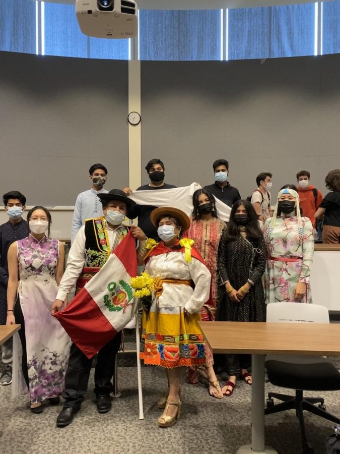 Traditions Day participants pose for a photo in room D195 on Sept. 23, 2021. They were all wearing clothes from their native countries. (photo by Khushi Gandhi)