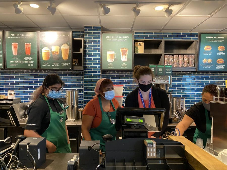 Starbucks employees work together at Harpers new Starbucks store on Sept. 27, 2021. (photo by Khushi Ghandi)